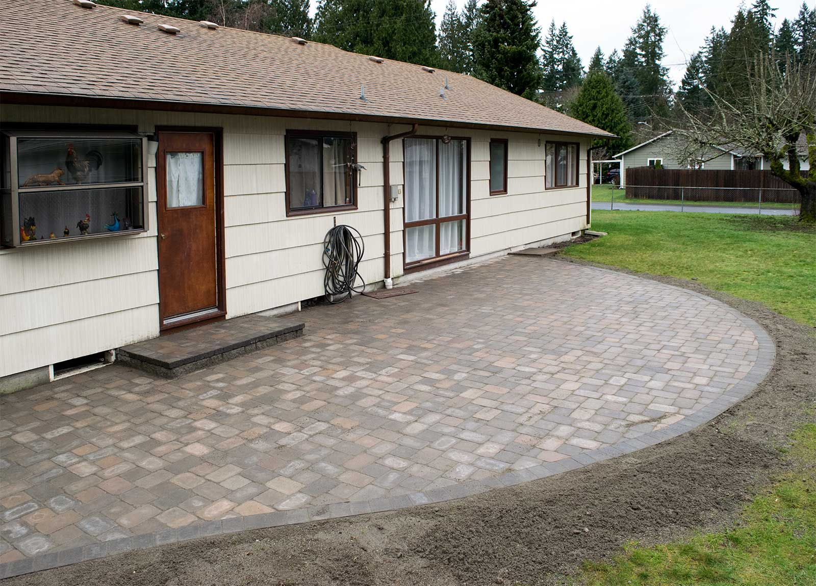 Roca Style Tumbled Paver Patio Brings New Life To This Lacey Rambleru0027s  Backyard. Point To