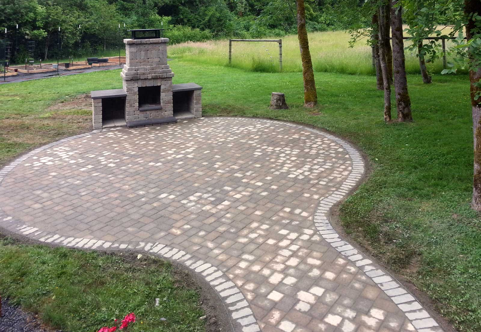 Firepit With Matching Paver Patio And Connecting Pathway.