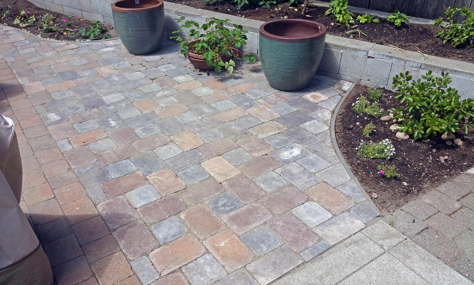 Adding Pavers To Concrete Patio Decorate Paver Patio Integrating Landscape Beds And Meeting A Concrete Slab