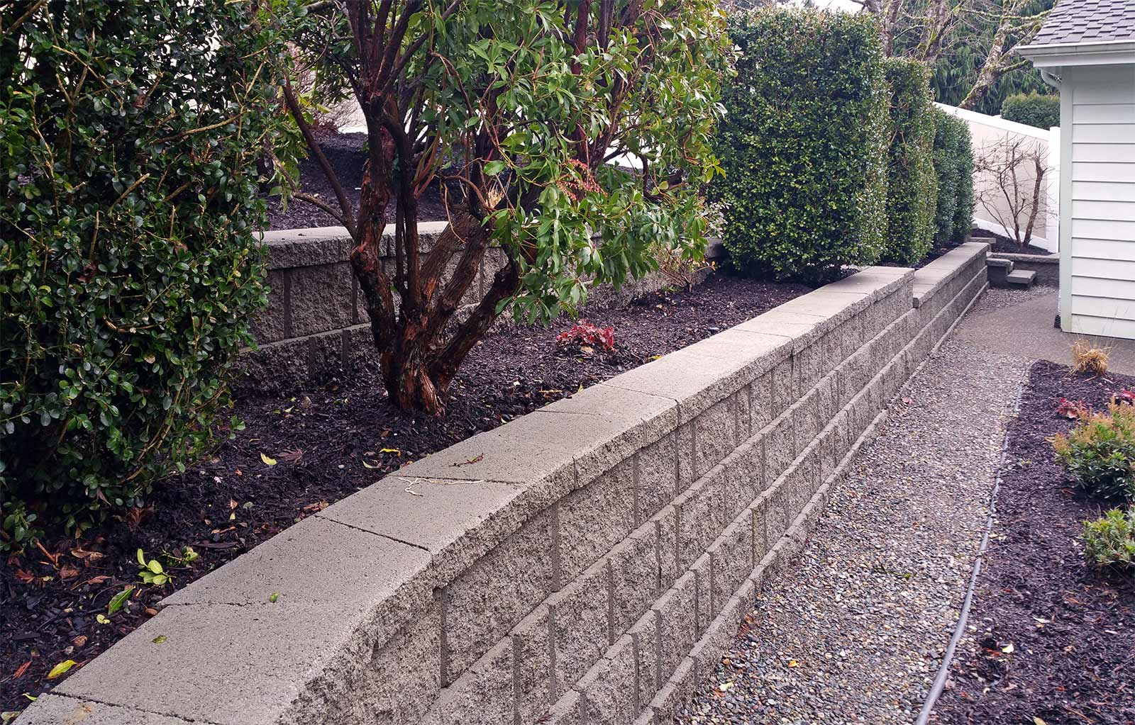 Tiered Retaining Wall With Vinyl Fencing In West Olympia