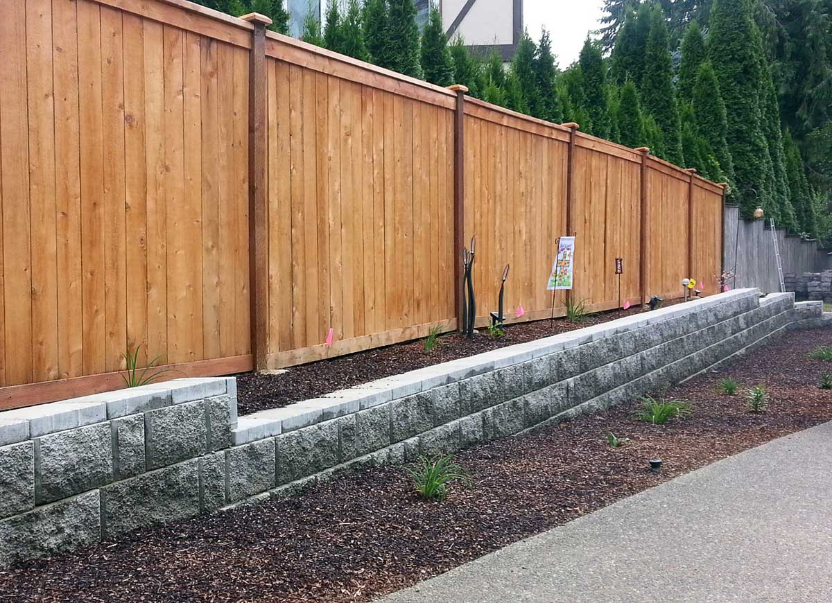 retaining wall and fence in olympia ajb landscaping fence