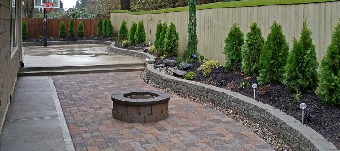 Landscaping fence installation retaining walls olympia for Landscaping rocks tacoma